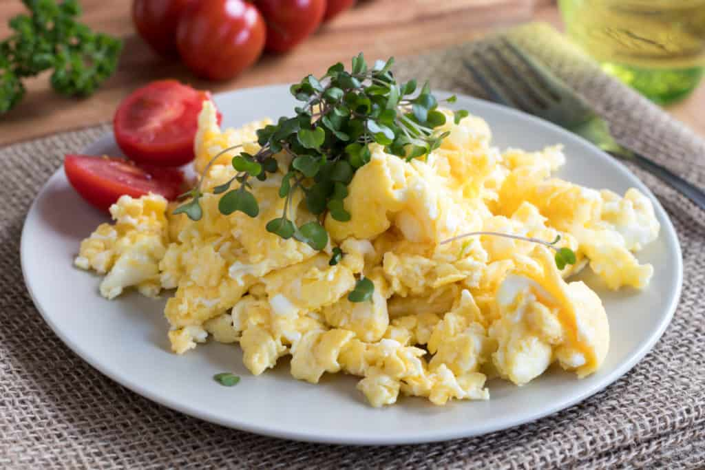 YayImages_HowDoYouEatMicrogreens_scrambled-eggs-with-fresh-microgreens-on-top